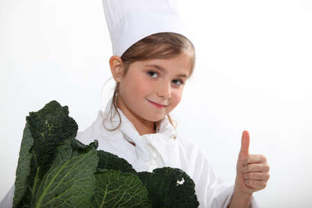 cuisine entertainment: Child cook with cabbage