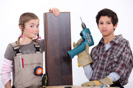 woodworking: children dressed as carpenters