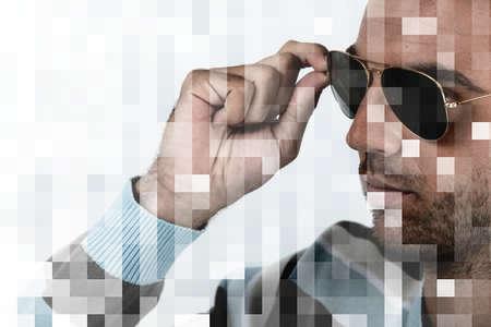 a man touching his sunglasses photo