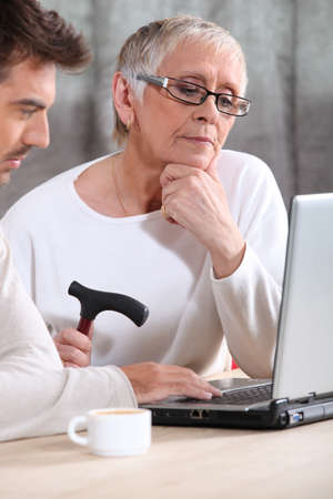 grandmother and grandson: Elderly woman learning internet skills Stock Photo
