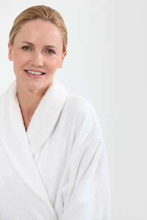 Woman in bath robe Stock Photo - 10782699