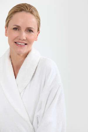 Woman in bath robe Stock Photo - 10782699