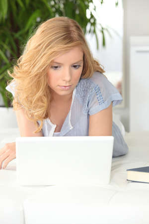 Teenager browsing on the Internet Stock Photo - 10783534