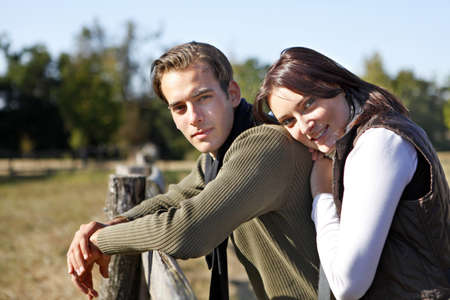 Couple enjoying a walk in the countryside Stock Photo - 10783468