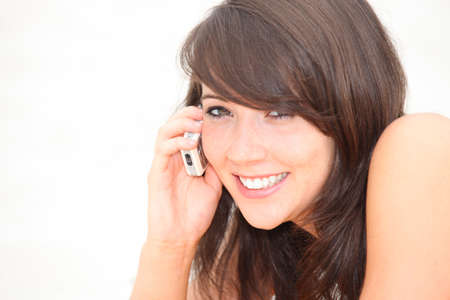 Woman talking on her mobile phone Stock Photo - 10782642