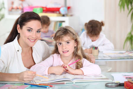 Three little girls in class Stock Photo - 10783491
