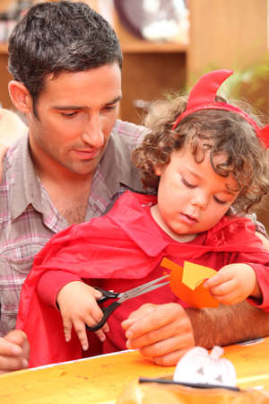 Dad with his child dressed as a devil for Halloween Stock Photo - 10783637