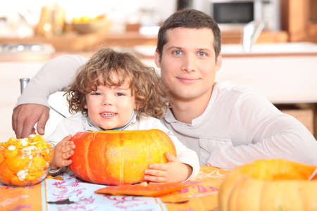 father and his little boy making a pumpkin pie Stock Photo - 10783193