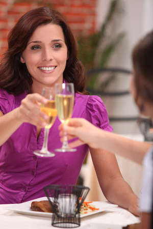 Two female friends drinking champagne in restaurant Stock Photo - 10782842