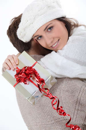 Couple hugging with gift in hand Stock Photo - 10783607
