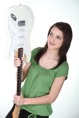 Woman beat guitar: Girl holding guitar