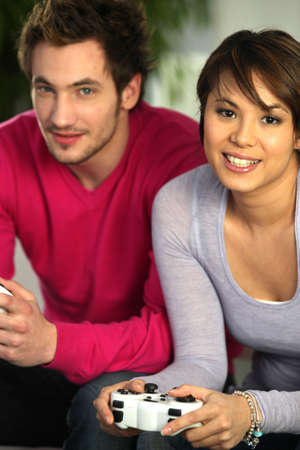 bedhead: young duo playing video games Stock Photo