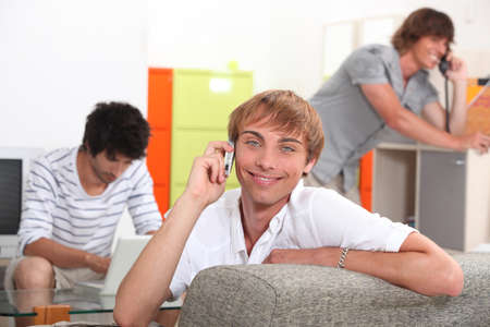 Three smiling lads communicating in different ways Stock Photo - 10783585