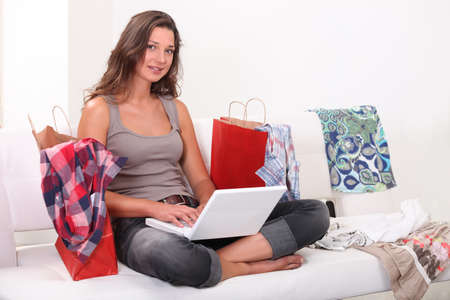 Woman surrounded by shopping bags Stock Photo - 10783352