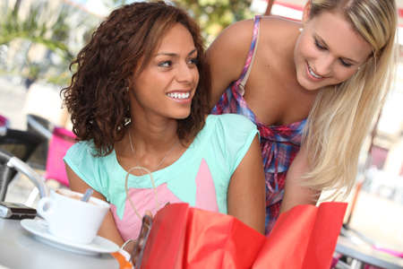 caf: Woman helping her friend Stock Photo