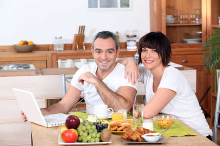 Couple having breakfast together Stock Photo - 10783559
