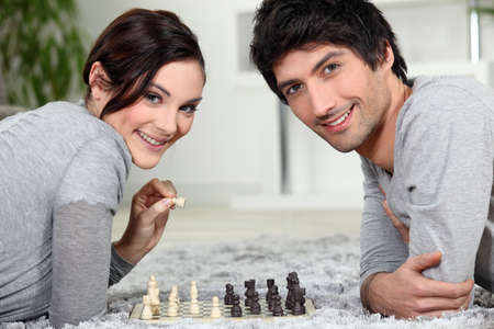 A couple playing chess photo