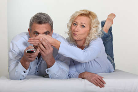 Couple watching television together Stock Photo - 10783484
