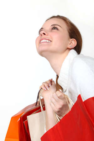delighted: Excited woman going home with her purchases