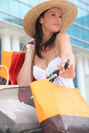 Woman on a bicycle with store bags Stock Photo - 10783547