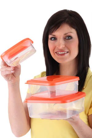 Girl carrying airtight boxes Stock Photo - 10782696