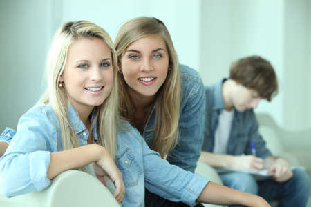 Two blond teenagers smiling at camera Stock Photo - 10783577