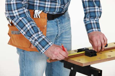 craftsman taking measurements photo