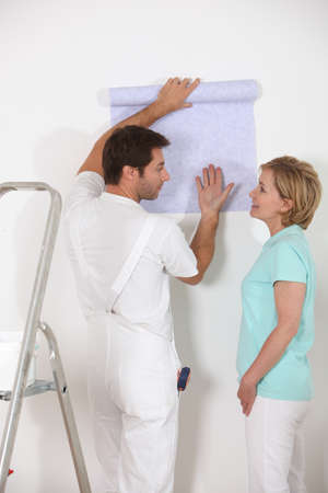 Couple discussing wallpaper photo