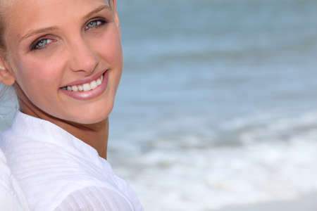 Attractive blond woman stood on the beach Stock Photo - 10783051
