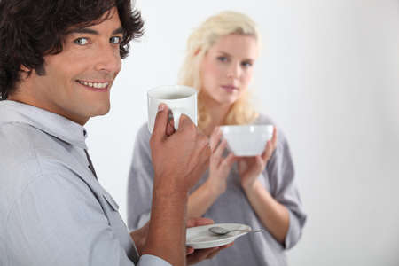 Couple drinking a hot drink photo