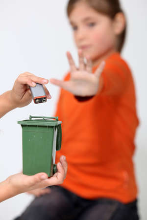 Kids illustrating improper disposal of batteries Stock Photo - 10782564