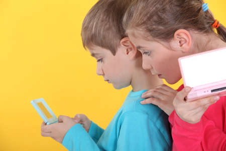 captivate: Children playing handheld video games