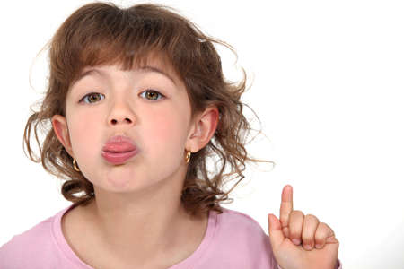 lip stick: little girl sticking her tongue out Stock Photo