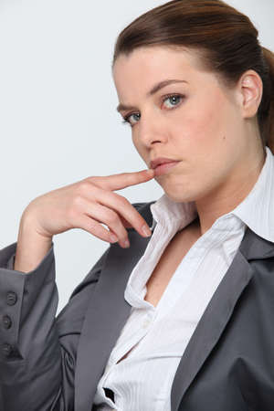 tilt: Profile of businesswoman holding hand to face Stock Photo