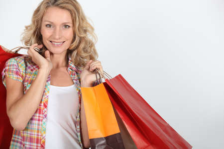 Woman with numerous shopping bags photo