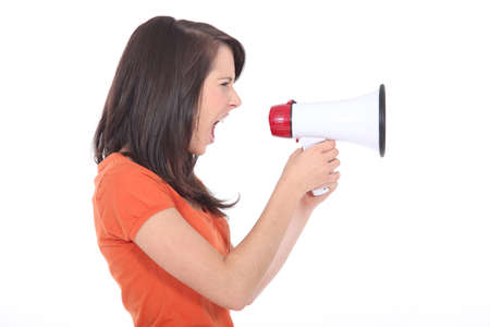 declare: young woman shouting through a megaphone