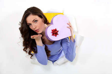 Woman with a heart shaped box of chocolates Stock Photo - 10782838