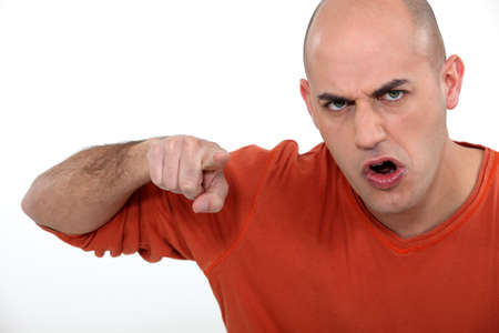 accusing: Angry man pointing his finger
