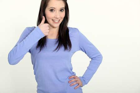 thumbsup: Brunette making thumbs-up gesture