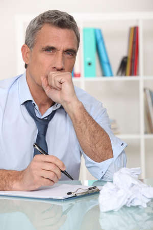 Man making himself sick from stress photo