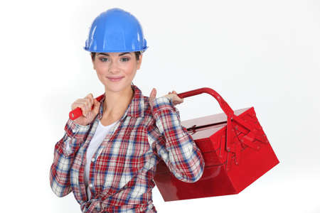 A handywoman holding a toolbox. photo