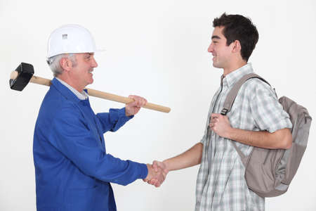 Experienced tradesman meeting his new apprentice Stock Photo - 10783579