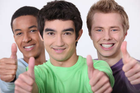 Three men giving thumbs-up sign photo