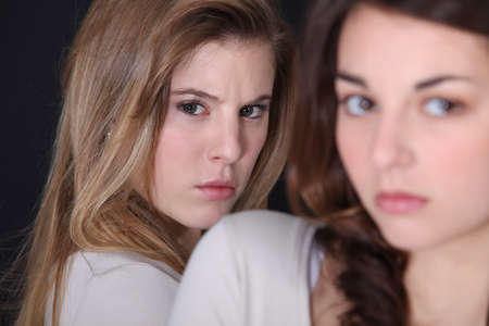 angry blonde: sisters Stock Photo