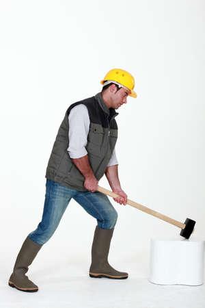Man using hammer photo