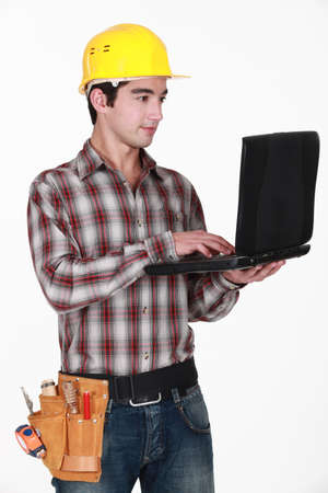 craftsman holding a laptop photo