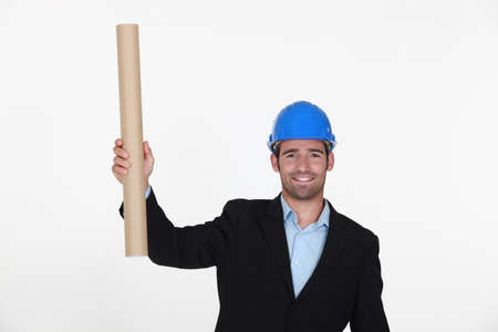 handsome architect showing plans Stock Photo - 10782537