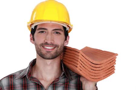 Tradesman holding shingles photo