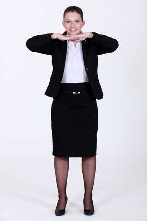 table skirt: Businesswoman leaning her chin on her hands. Stock Photo