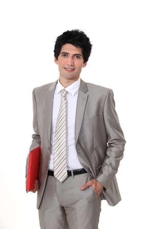 Businessman with a folder Stock Photo - 10783597
